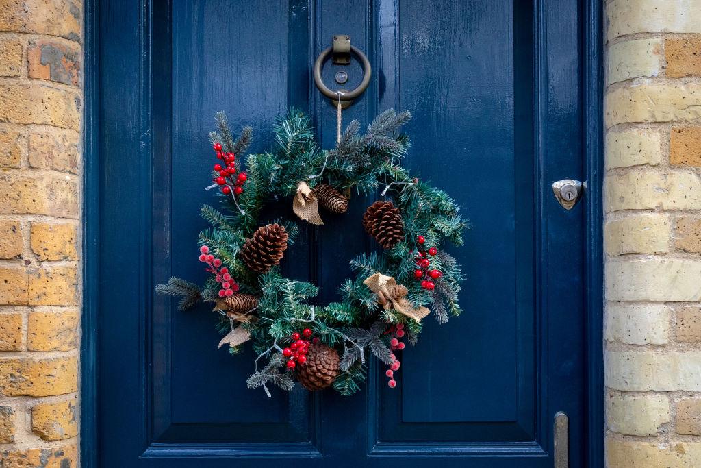 A Christmas wreath hangs on the front door