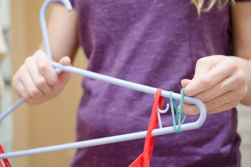 Attach Rubber Bands To Hanger Arms So Clothes Stay Put