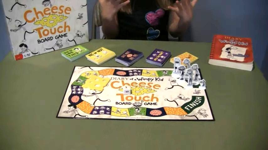 The Cheese Touch boardgame is laid out on a table with it's pieces set up.
