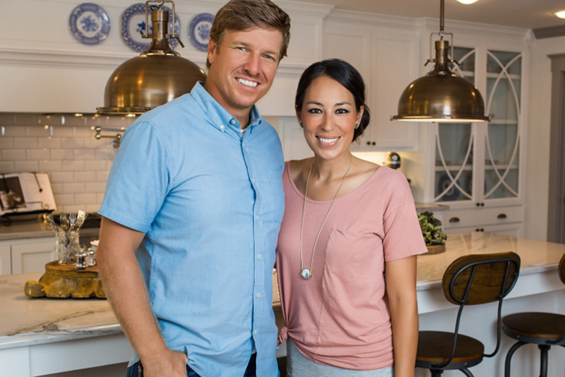 Hosts Chip and Joanna Gaines pose for a portrait in the kitchen of the newly renovated Ferguson home, as seen on Fixer Upper.