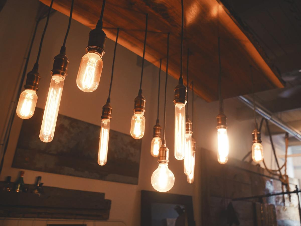 Edison bulbs hang from the ceiling in a kitchen.