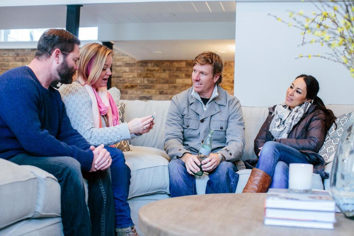 Joanna and Chip Gaines talk to the Fuch family about a bottle they found in their backyard.