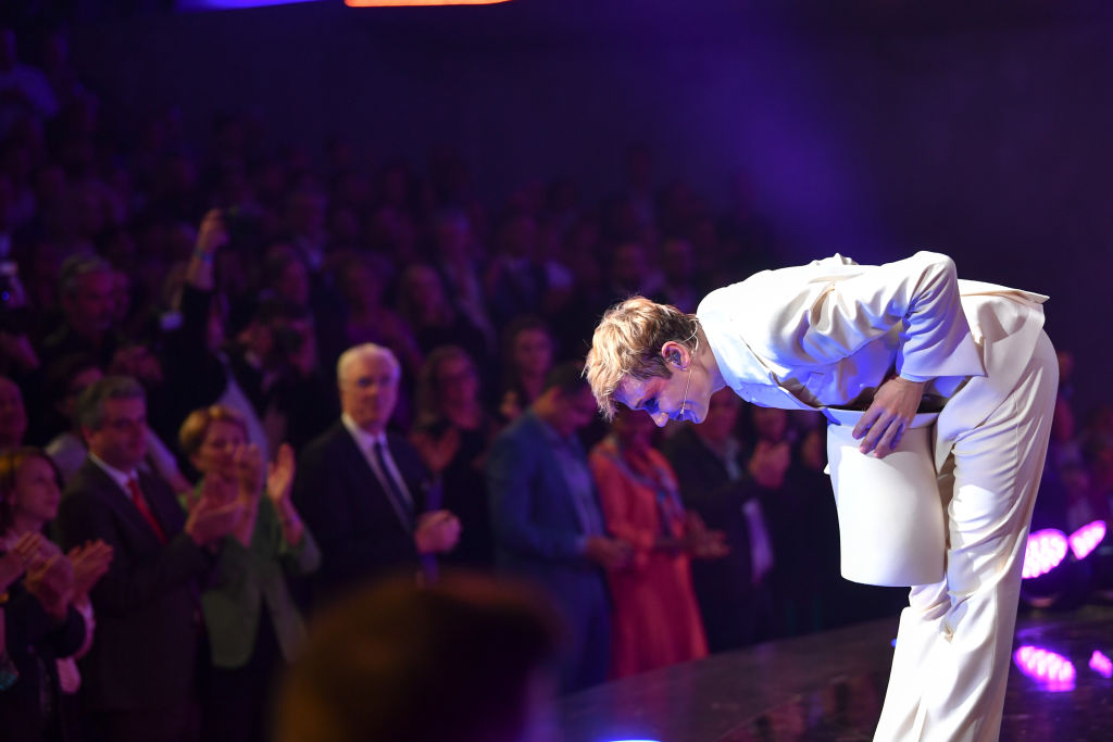 A man takes a bow onstage.