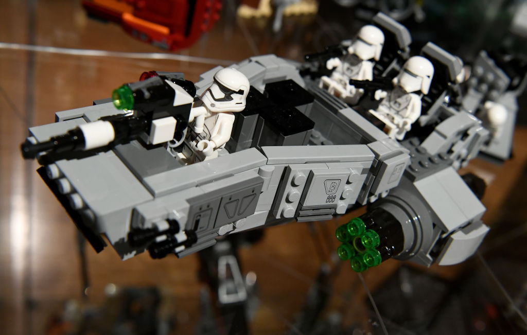 A Star Wars Lego model shows Storm Troopers riding in a battleship.
