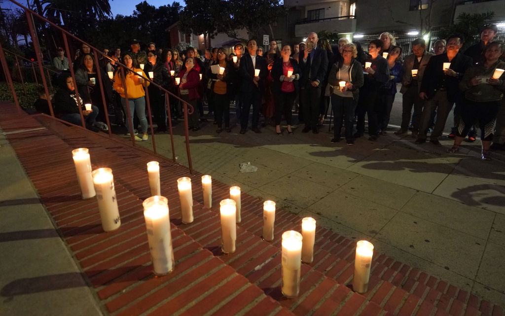 A community participates in a candlelight vigil.