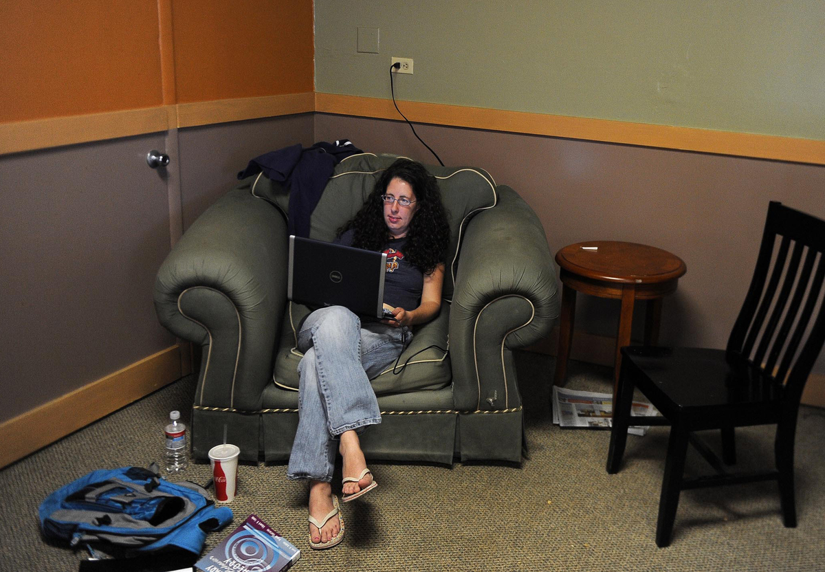 Lisa Fabrizio enjoys a comfy overstuffed chair in a quiet corner at Blueberry's Bakery & Cafe in Littleton.
