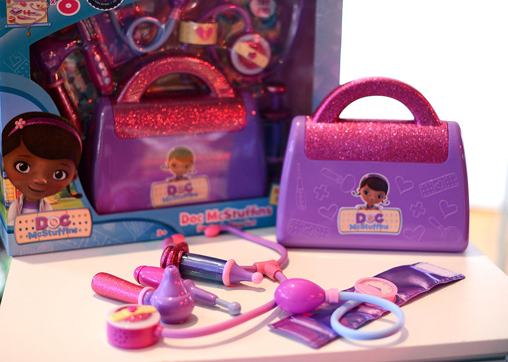 A Doc McStuffins toy set is displayed on a table.