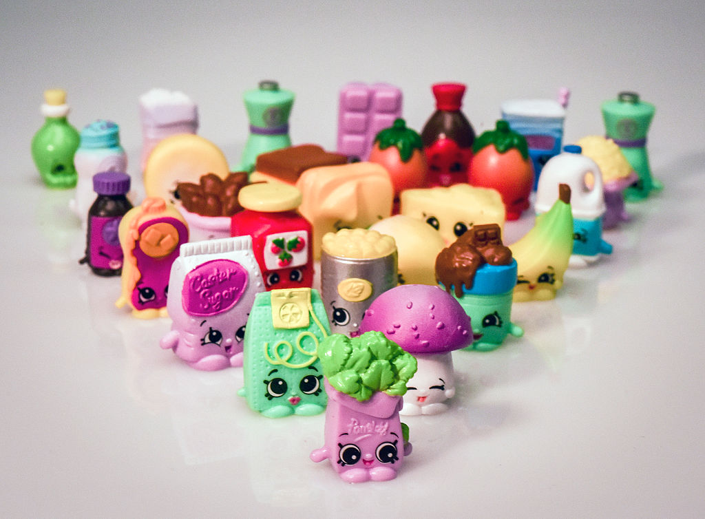 Various Shopkins characters are placed on an all-white surface.