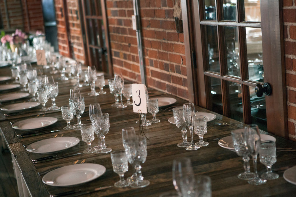 An unoccupied table is dressed for a wedding reception.