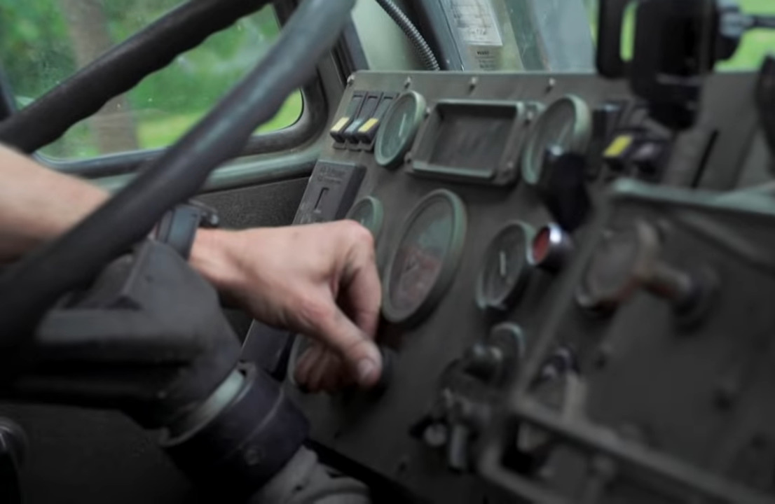 Behind the truck's steering wheel are several buttons and switches that are not in the average vehicle.
