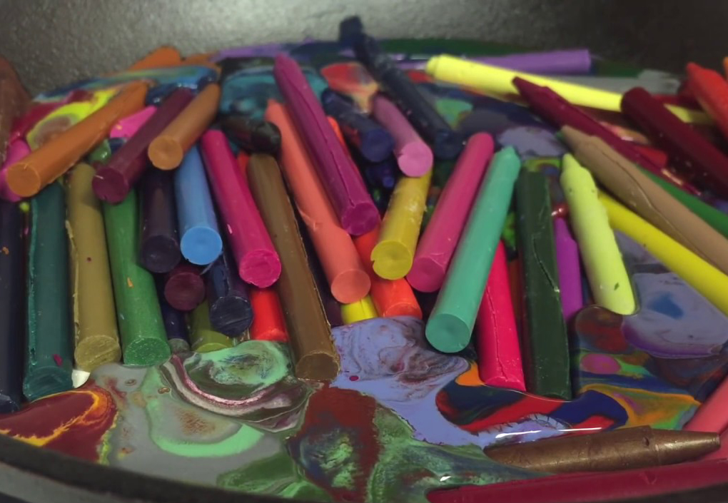 Crayola crayons melt in a pan in the oven.