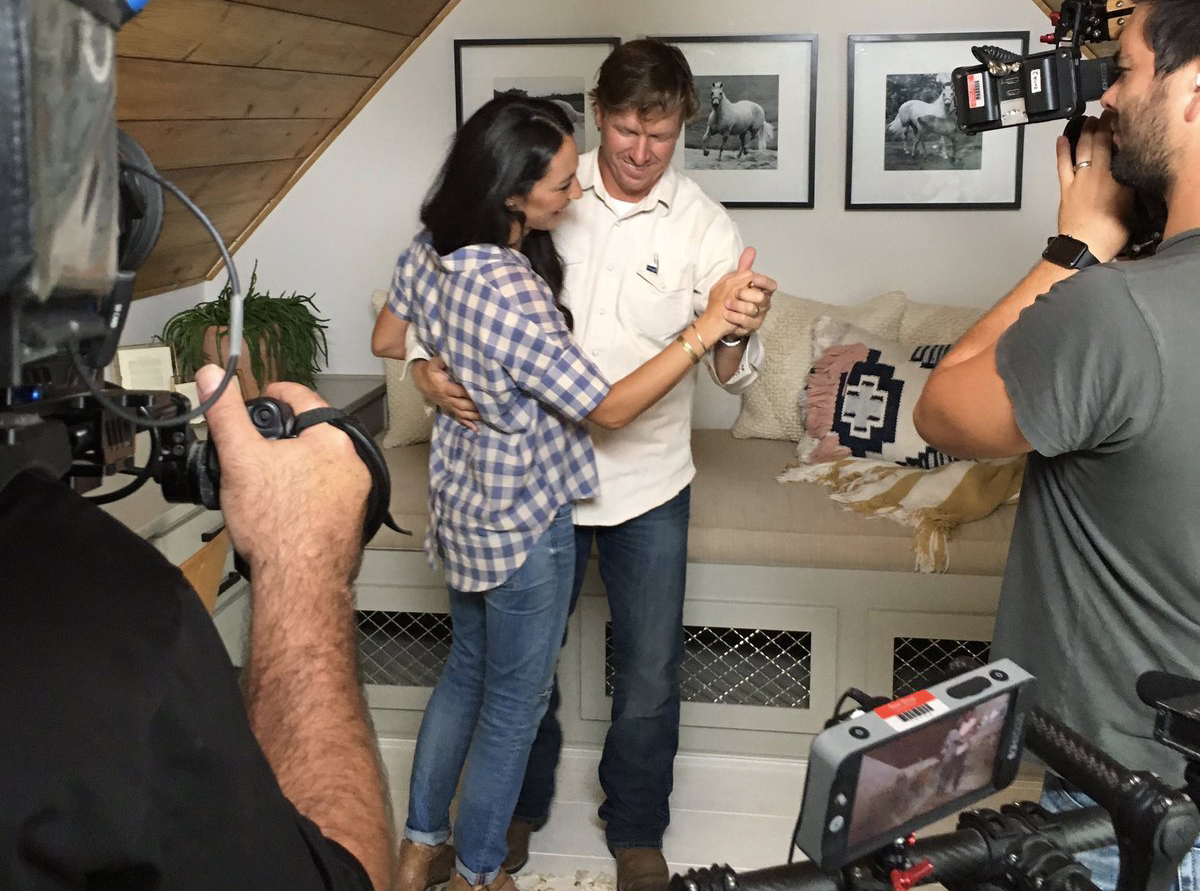 Joanna and Chip Gaines dance while on camera.
