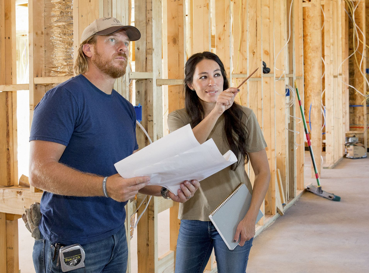 Chip and Joanna Gaines check the blueprints during home construction on Fixer Upper.