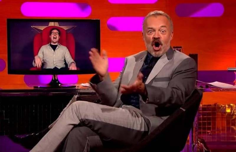 Graham Norton has wide eyes and an open mouth after hearing Sean's story.