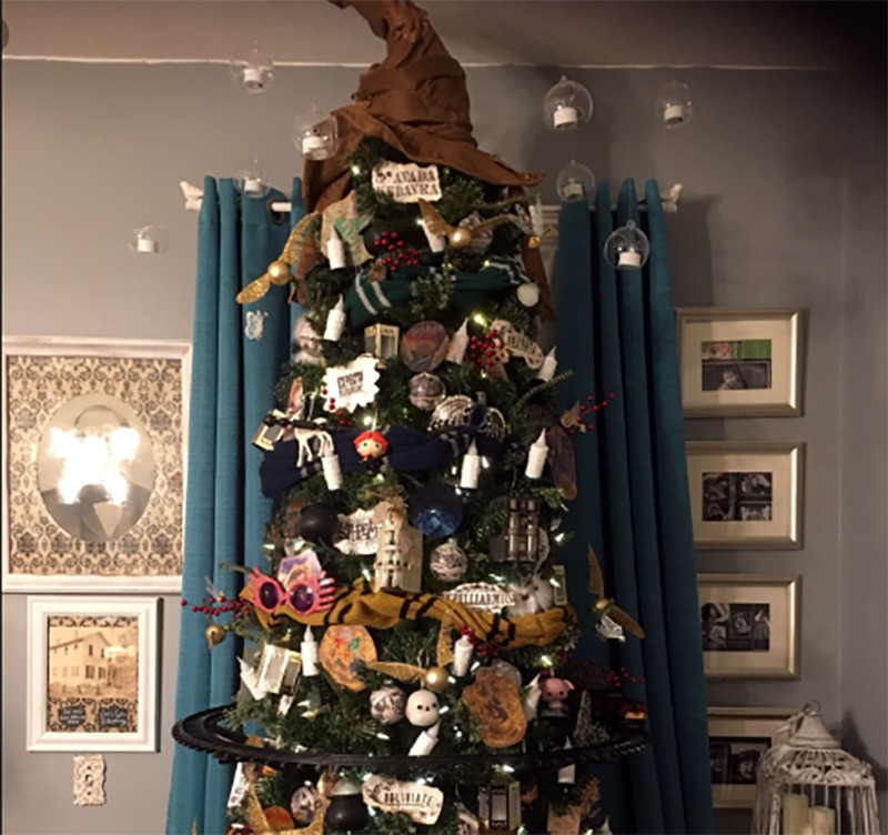 A Christmas tree is covered in Harry Potter decorations.