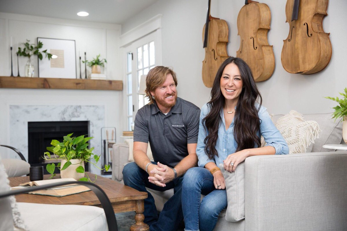 Joanna and Chip Gaines sit in a living room.