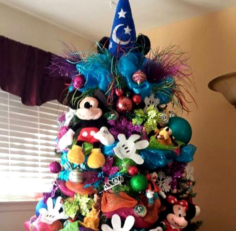 A Christmas tree is covered in Mickey Mouse decorations.