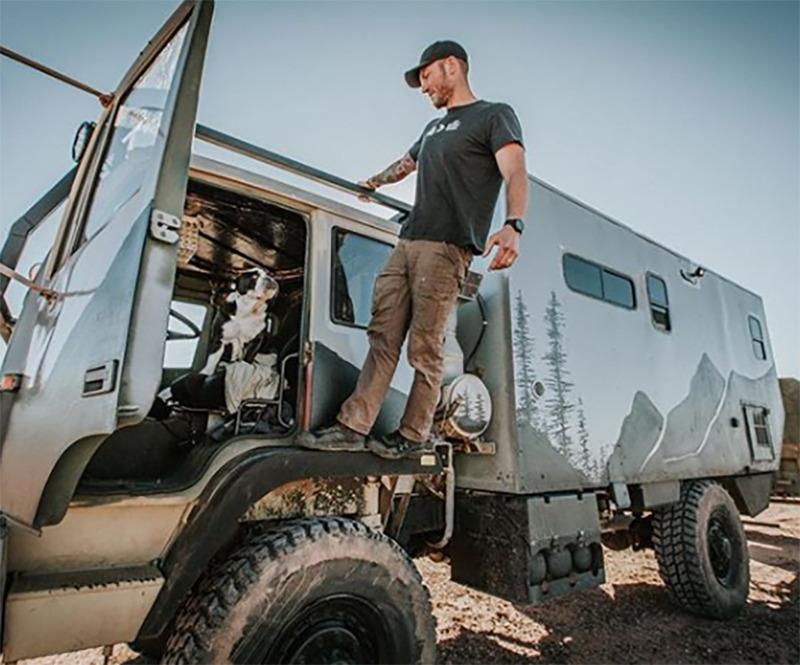 Trevor hangs off of the truck.