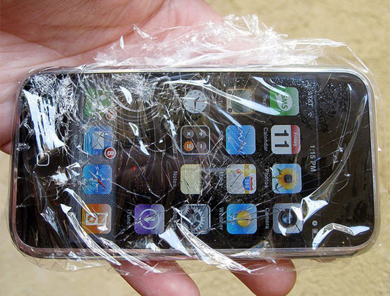 Plastic wrap covers an Apple smart phone.