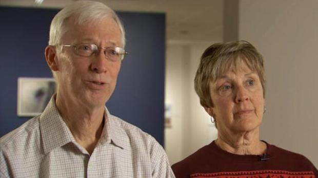 Kati's adoptive parents look serious.