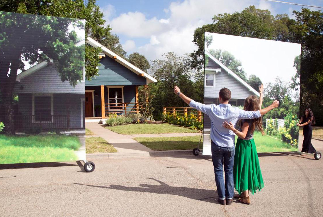 Joanna and Chip Gaines remove the giant poster to reveal a new home for participants of 'Fixer Upper.'