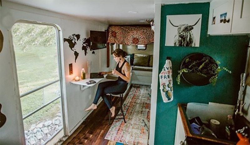 Kourtney sits on her laptop in the tiny home.