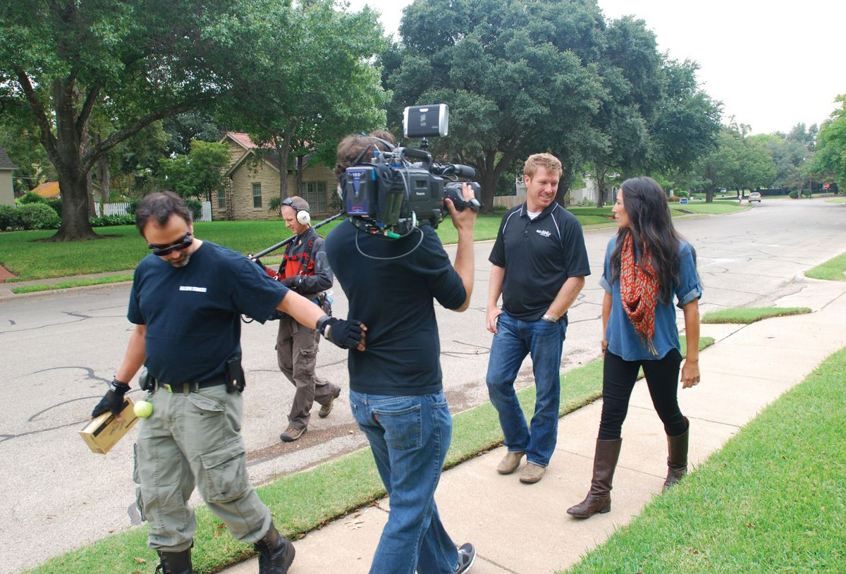 Chip and Joanna Gaines are filmed as they walk down the streets of Castle Heights.