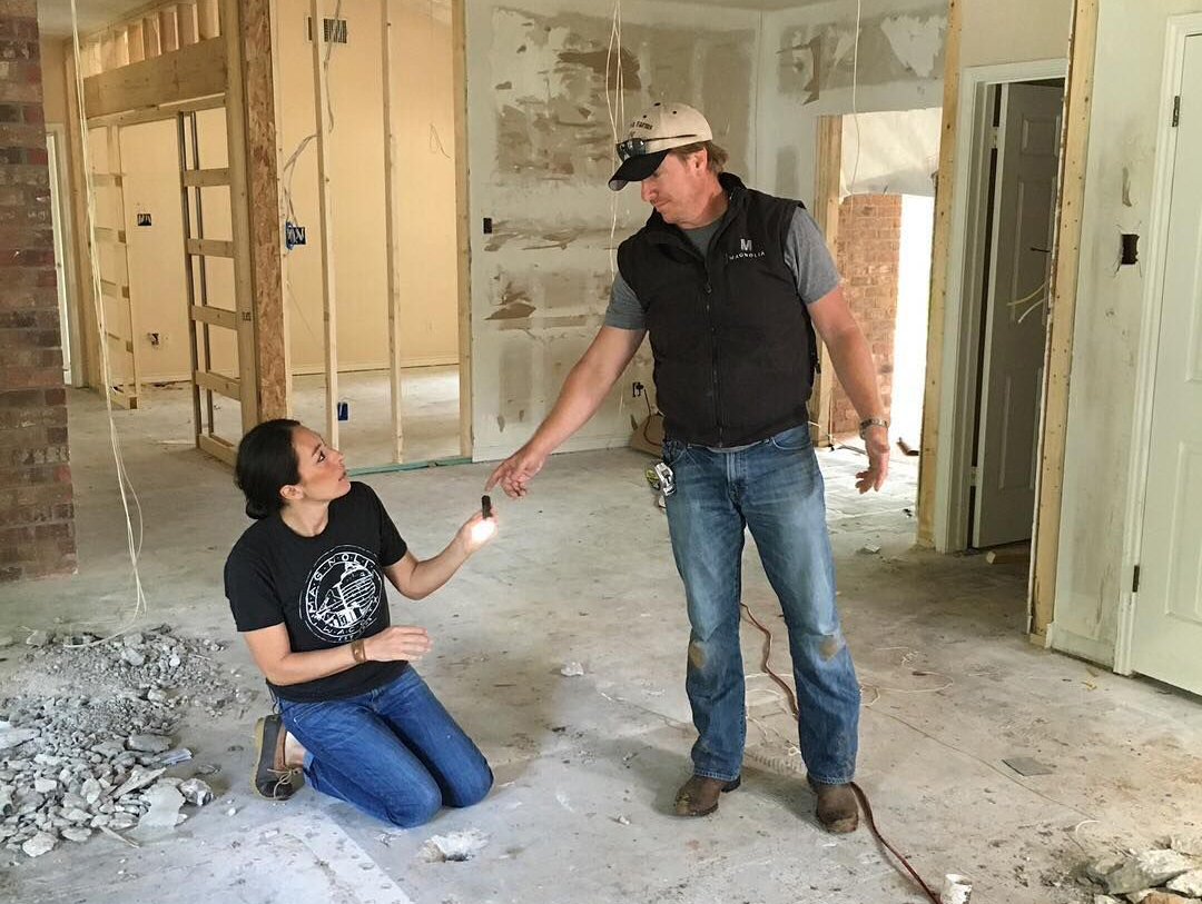 Chip and Joanna Gaines work on a home.