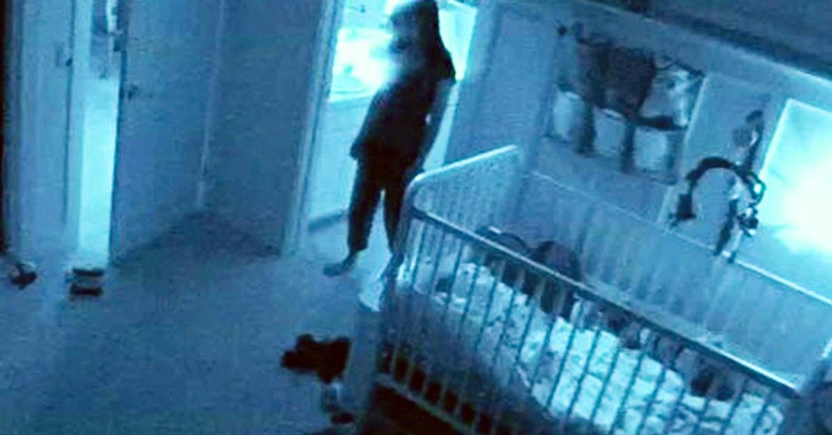 hidden camera footage of a woman standing near a crib
