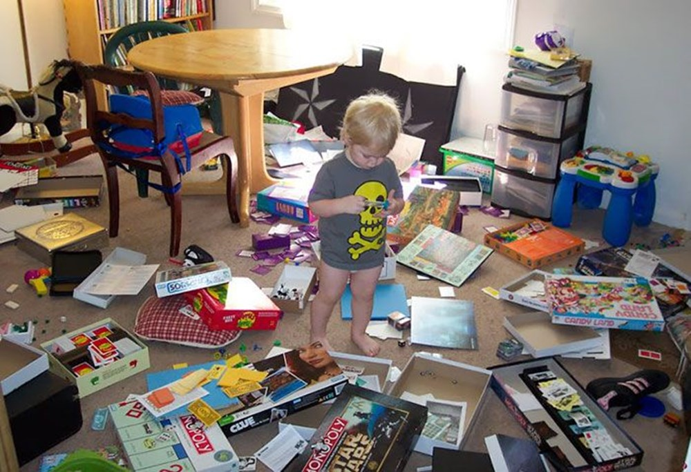 child makes mess with board games