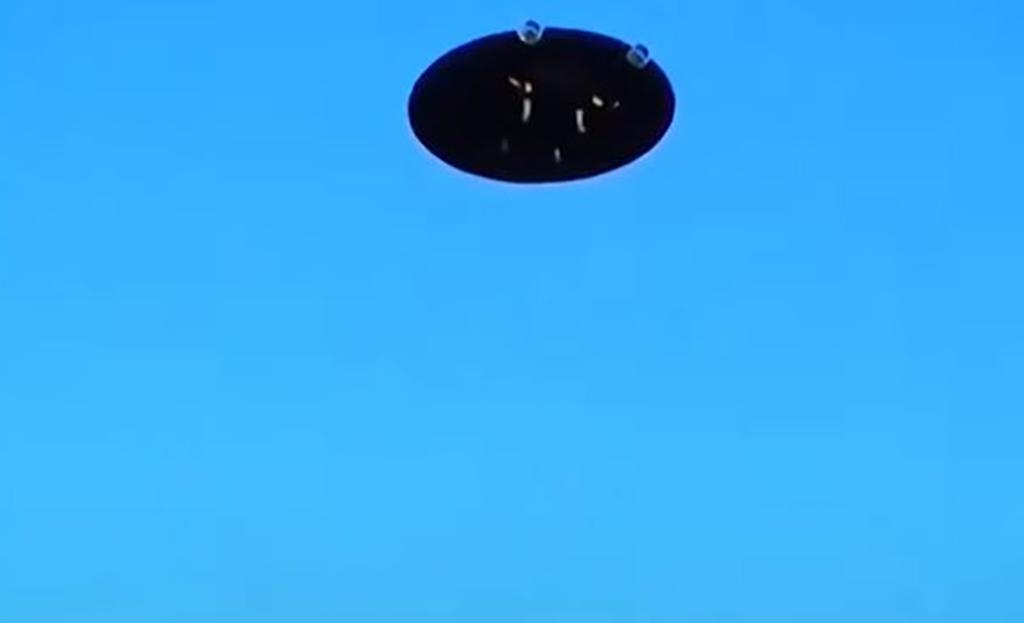 Saucer in blue sky