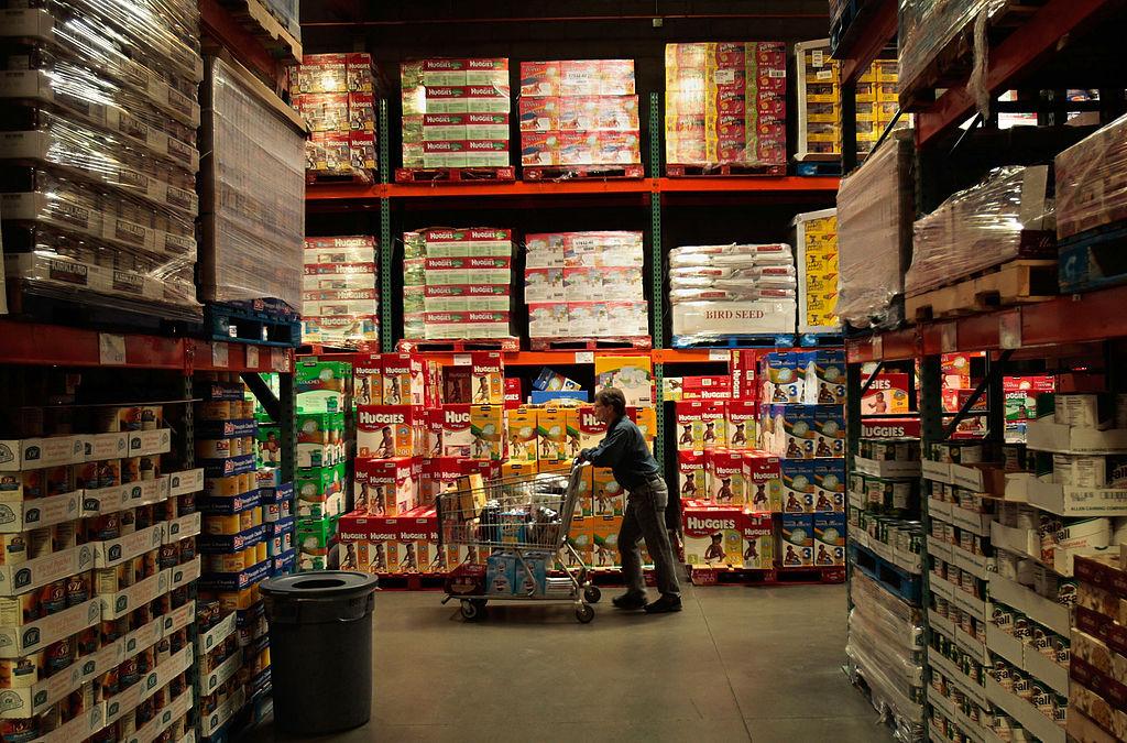 A shopper pushes a cart through the aisles of a Costco store