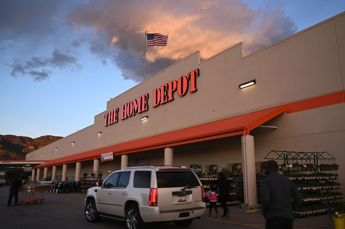 A Home Depot store waves the American flag.