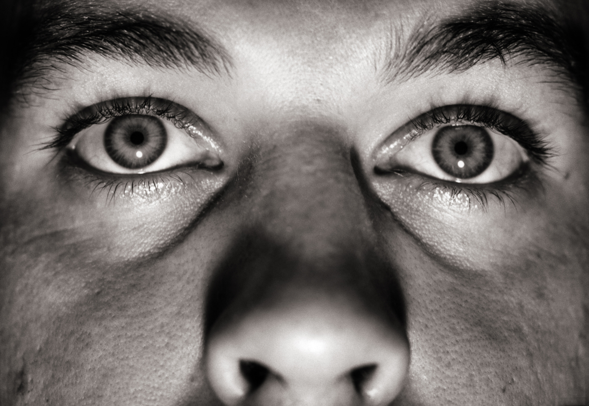 A man's eyes and nose are seen in a close-up.