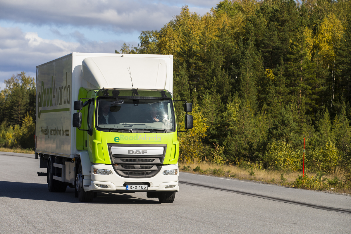 A moving truck drives down the road in Sweden.