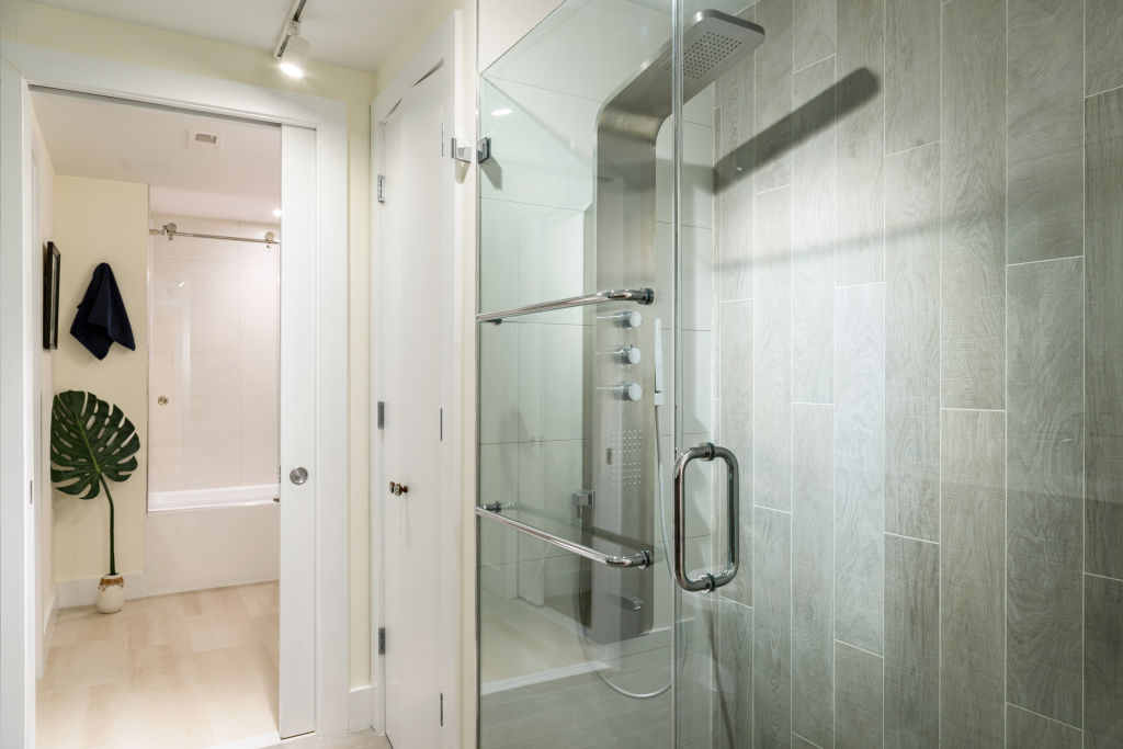 A clean shower has glass doors.
