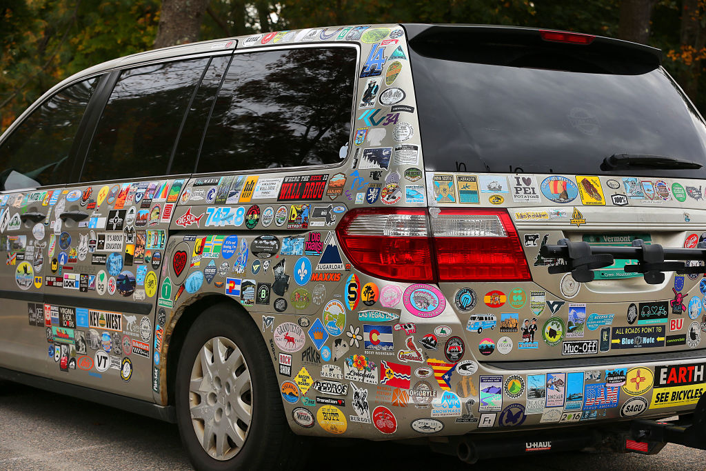 A van is covered in stickers.