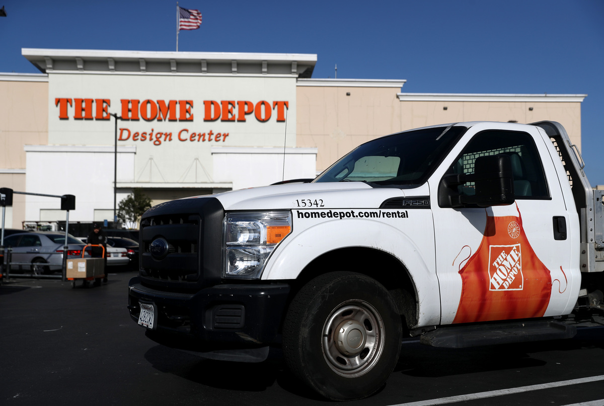 A Home Depot rental truck is parked in the background.