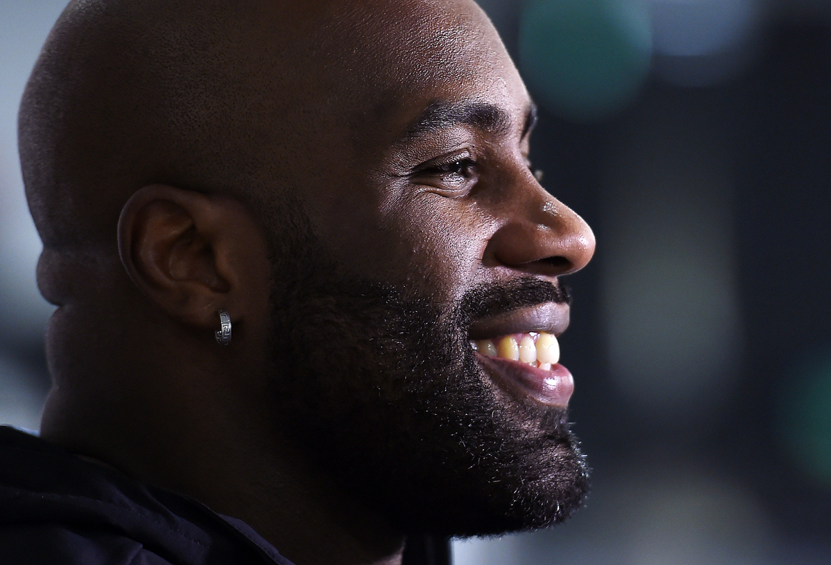 French judo legend Teddy Riner smiles during an interview.