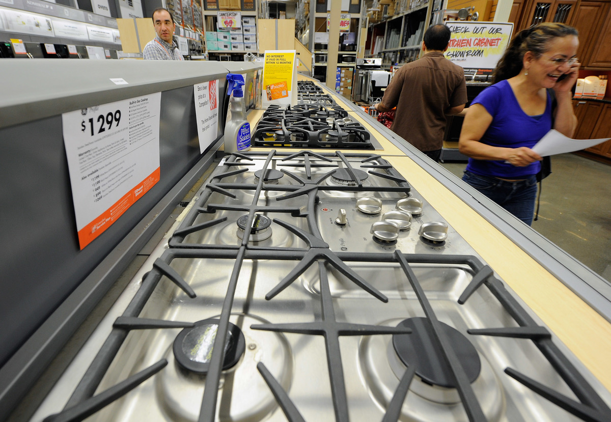 Customers shop for kitchen appliances at the Home Depot.