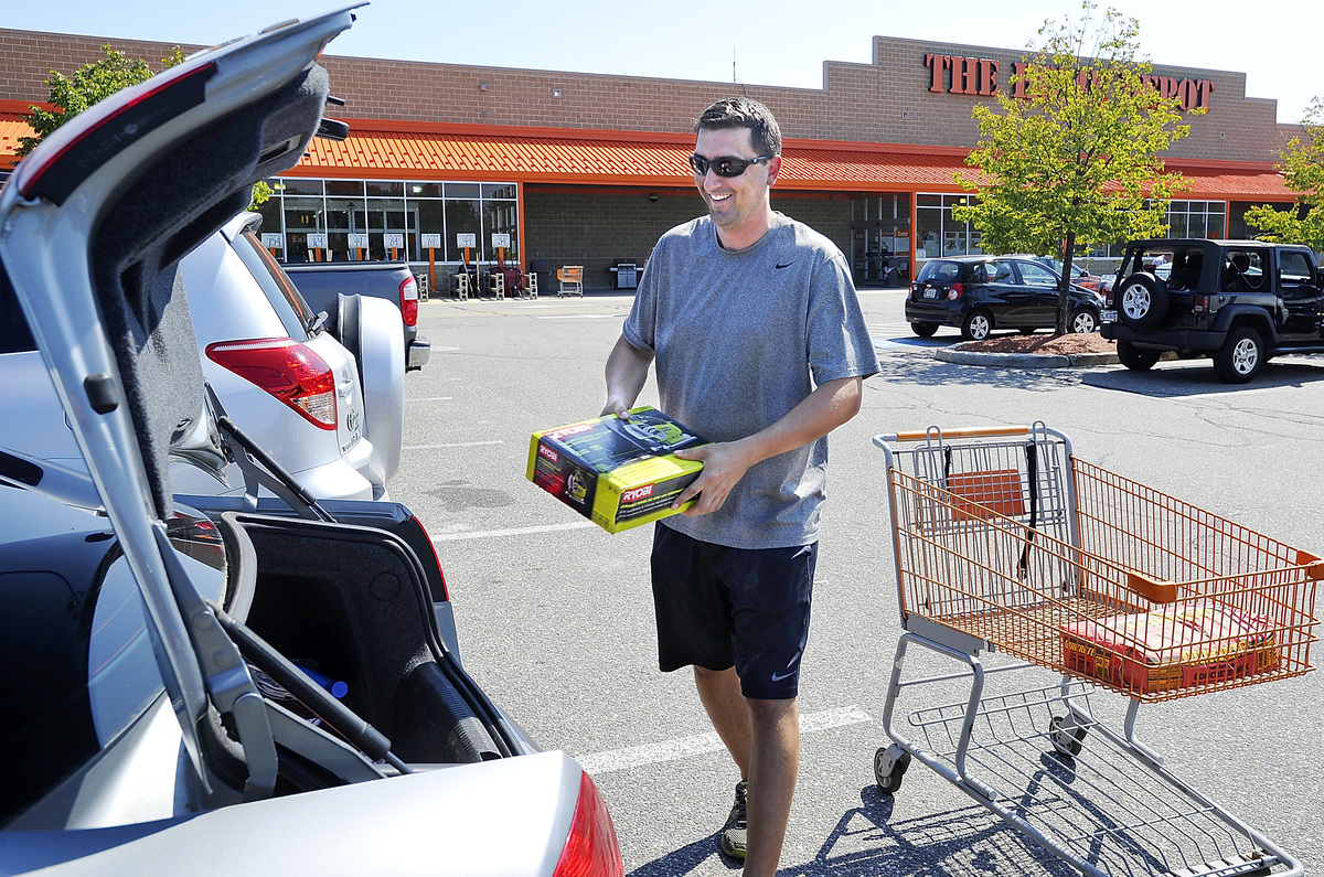 Kurt Hein of Portland puts his items bought at Home Depot with his credit card into his trunk.