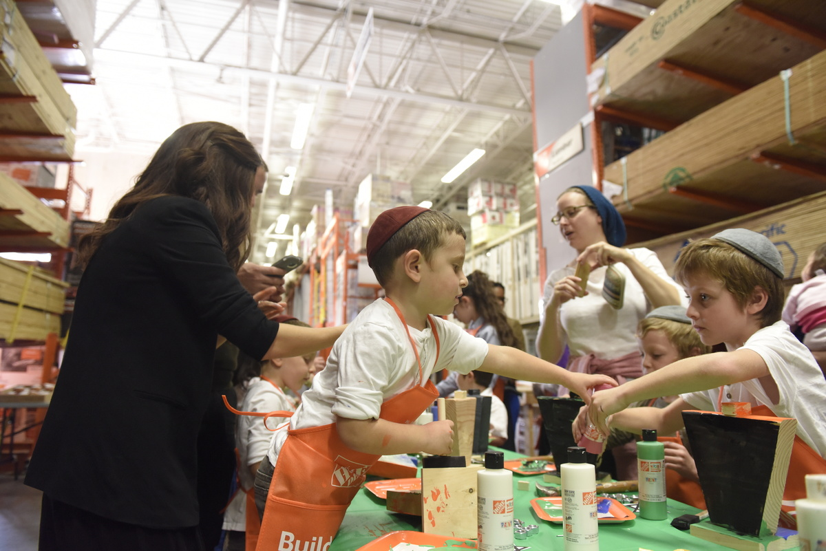 Kids participate in a crafting class at Home Depot.