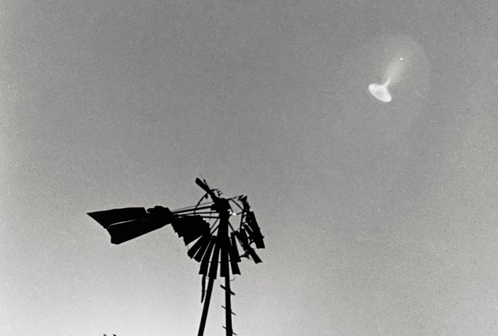 UFO over windmill