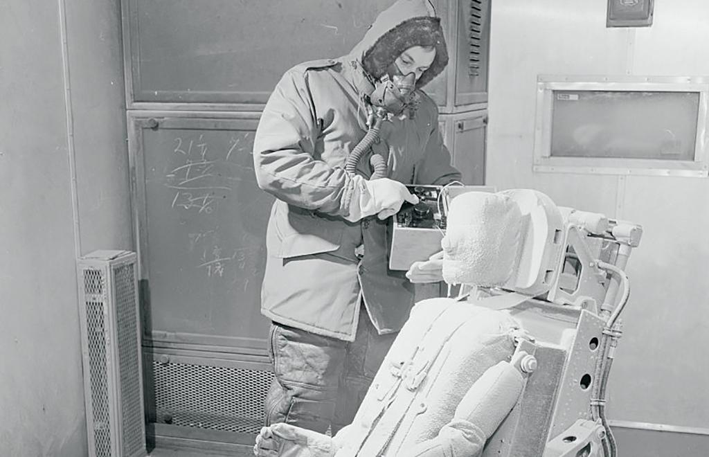 Man working with crash-test dummy