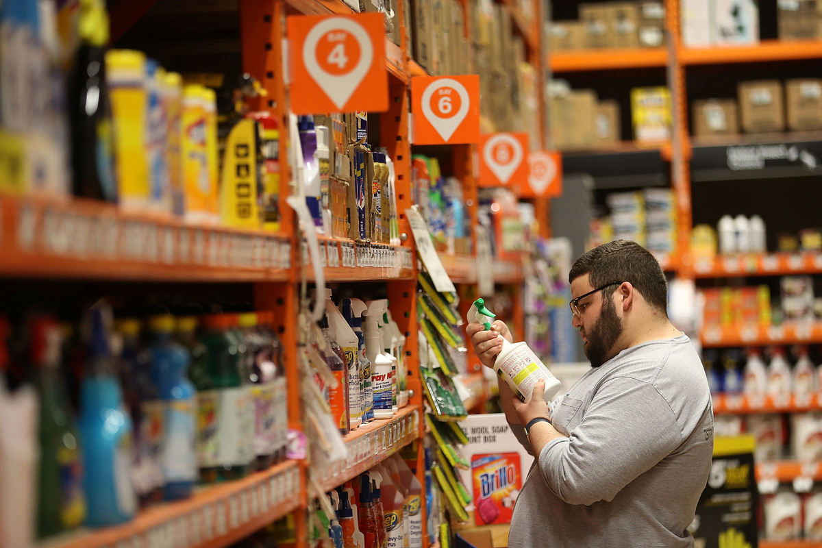 A customer shops for cleaning supplies at Home Depot.