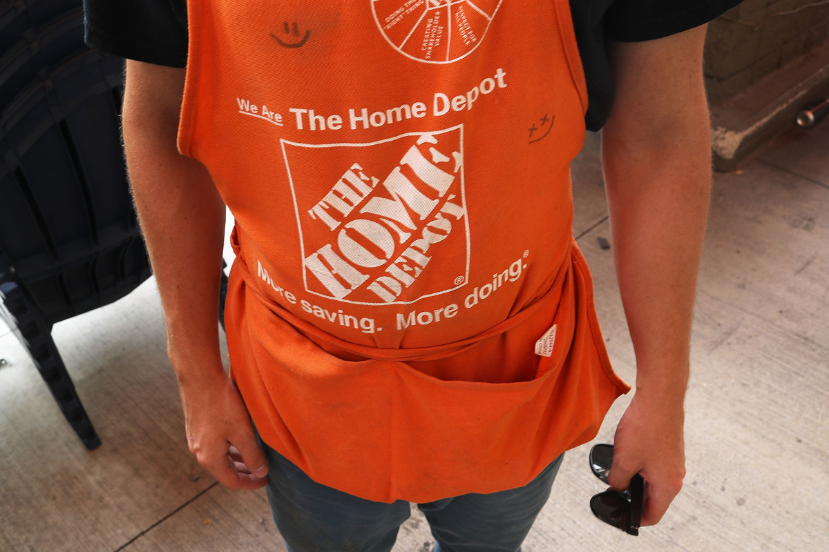 An employee at Home Depot wears his apron.