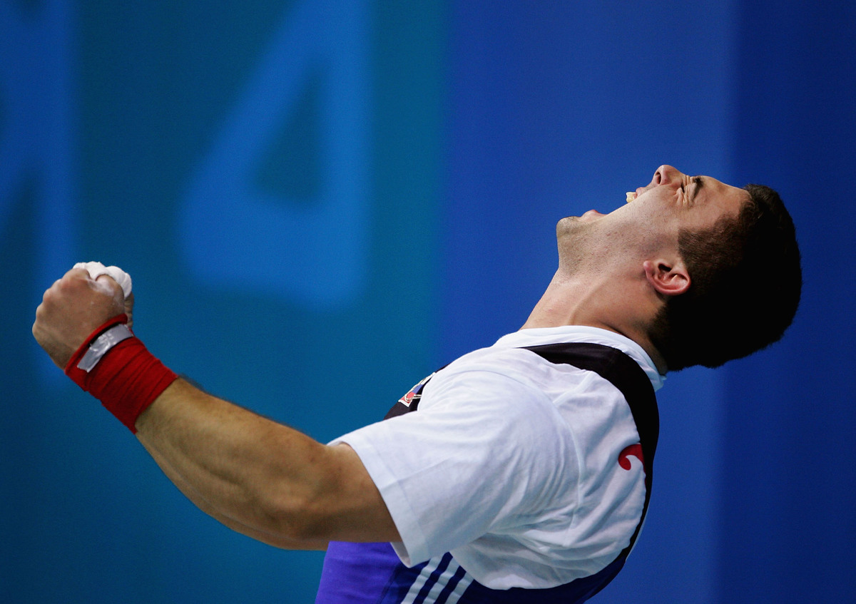 Gold medal winner Dmitry Berestov of Russia celebrates winning the gold medal.