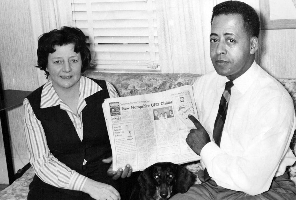 Man and woman with newspaper clipping