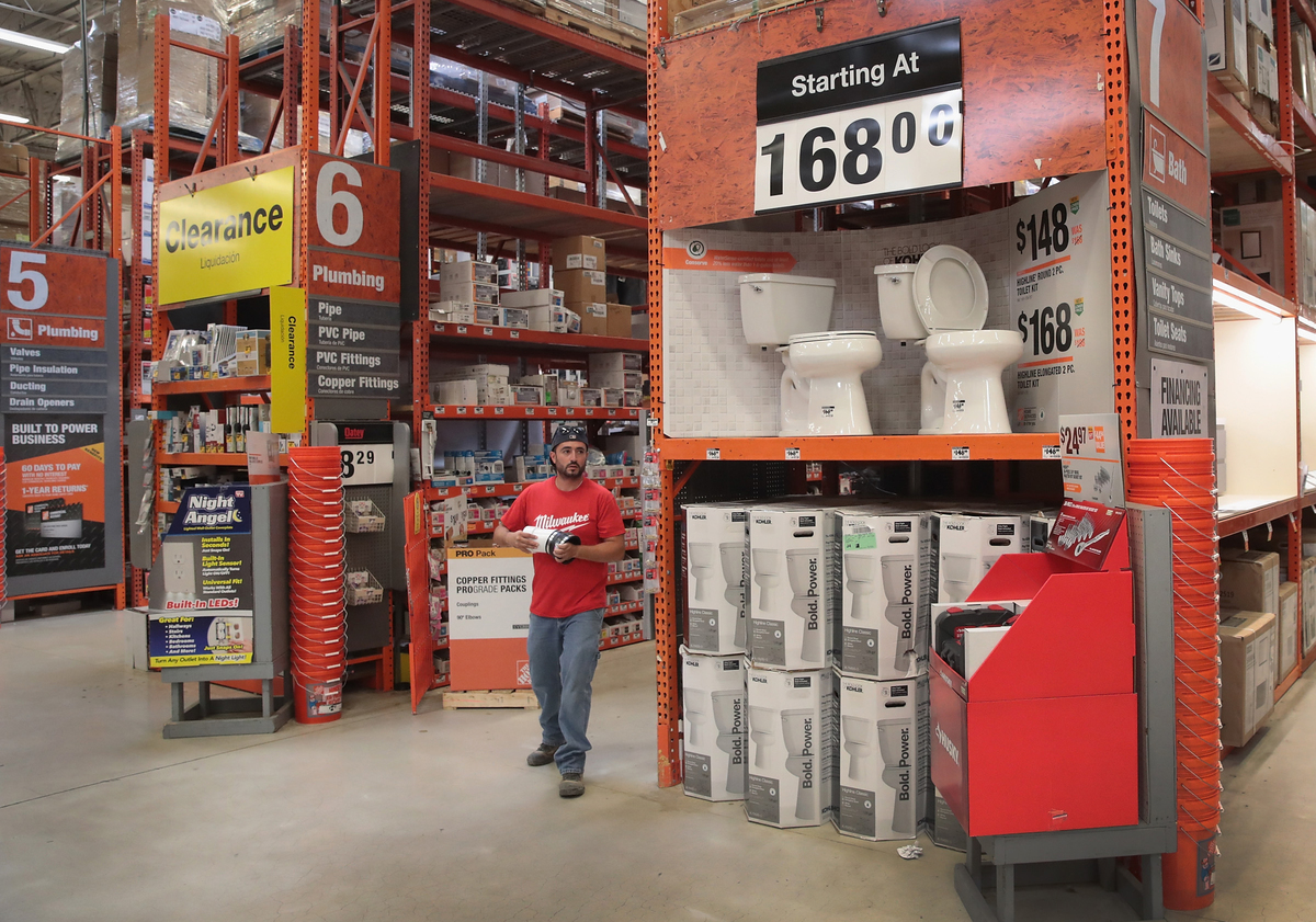 A customer stands by the clearance aisle at Home Depot.