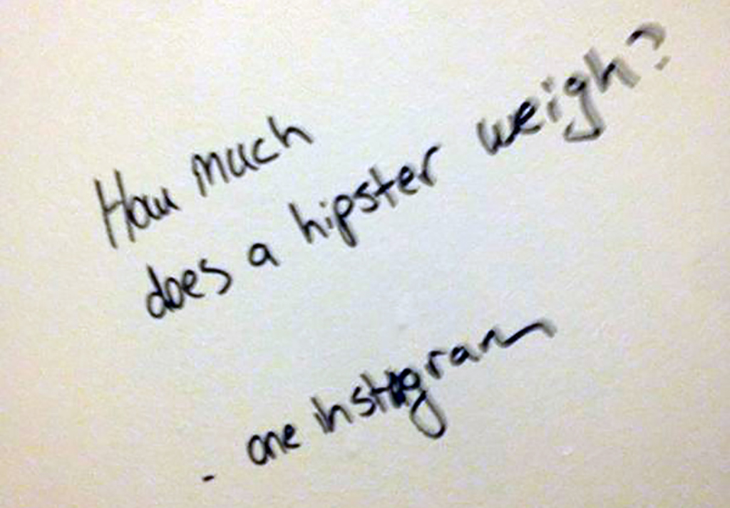 A bathroom wall reads,